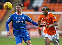Blackpool's Nathan Delfouneso chases a ball under pressure from Portsmouth's Oliver Hawkins<br /> <br /> Photographer Alex Dodd/CameraSport<br /> <br /> The EFL Sky Bet League One - Blackpool v Portsmouth - Saturday 11th November 2017 - Bloomfield Road - Blackpool<br /> <br /> World Copyright &copy; 2017 CameraSport. All rights reserved. 43 Linden Ave. Countesthorpe. Leicester. England. LE8 5PG - Tel: +44 (0) 116 277 4147 - admin@camerasport.com - www.camerasport.com