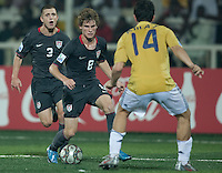 Alex Shinsky (8) controls the ball against Jordi Amat (14).. Spain defeated the U.S. Under-17 Men National Team  2-1 at Sani Abacha Stadium in Kano, Nigeria on October 26, 2009.