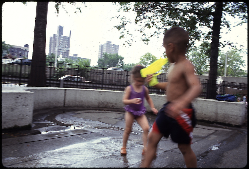 Lucia Licht, playing in the waterpark by the Williamsburg Bridge with another local kid.  Williamsburg Brooklyn, New York 08-97