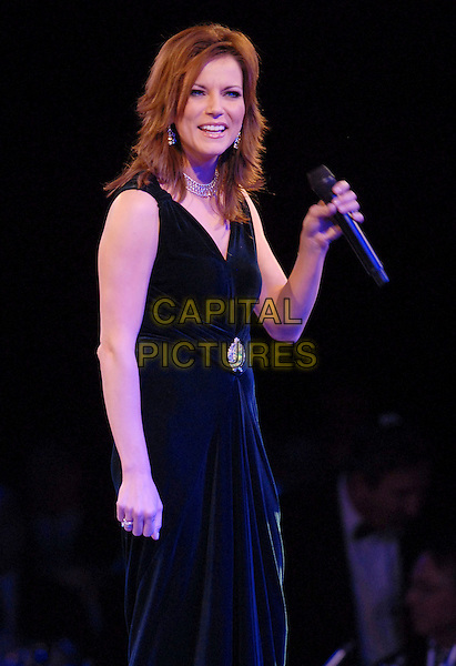 MARTINA McBRIDE.54th Annual BMI Country Awards - Show,.held at BMI's Music Row Headquarters,  Nashville, Tennessee, USA,04 November 2006..half length live on stage concert gig black dress microphone.Ref: ADM/LF.www.capitalpictures.com.sales@capitalpictures.com.©Laura Farr/AdMedia/Capital Pictures.