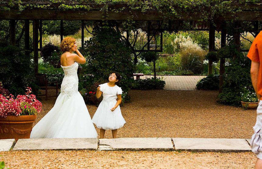 Tender Moment: Flower Girl Gives Bride A Gift