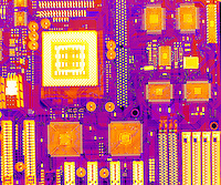 An X-ray of a Computer Board. This is the motherboard, the circuit board controlling a computer.