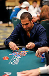 James Calderaro goes all in and then scoops some of Lisa Hamilton's chips after winning the hand.