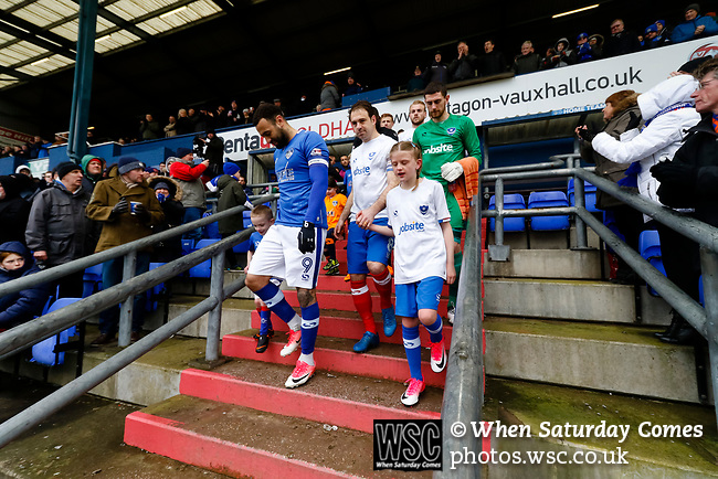 Craig Davies of Oldham and Brett Pitman of Portsmouth lead their teams onto the pitch. Oldham v Portsmouth League 1