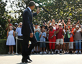 United States President Barack Obama waves to onlookers as he departs for travel to campaign events in Texas, from the White House in Washington, D.C., U.S., on Tuesday, July 17, 2012.  .Credit: Jonathan Ernst / Pool via CNP