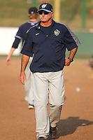 Hillsboro Hops pitching coach Doug Drabek (15) during a game against the Everett Aquasox at Everett Memorial Stadium in Everett, Washington on July 5, 2015.  Hillsboro defeated Everett 11-4. (Ronnie Allen/Four Seam Images)