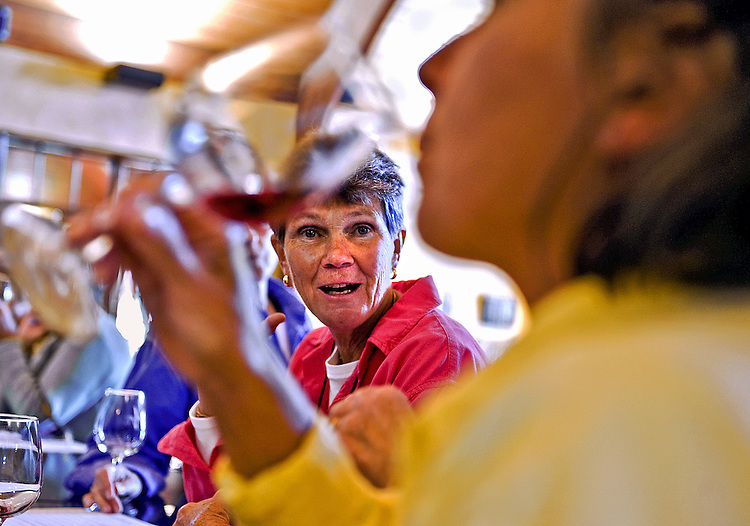In addition to producing wine, Anyela's Vineyards has wine tastings almost every day of the year. The vineyard tastings attract wine lovers from all over the Central New York area. Cortland natives Evelyn Sammons, pink, and Chris Frare, foreground, have been to multiple tastings.