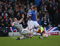 David Templeton being pressured by Michael Keenan in the Queen's Park v Rangers Irn-Bru Scottish League Division Three match played at Hampden Park, Glasgow on 29.12.12. .