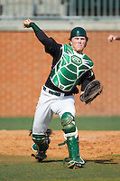 Patric King (28) of the Charlotte 49ers makes a throw to first base against the Canisius Golden Griffins at Hayes Stadium on February 23, 2014 in Charlotte, North Carolina.  The Golden Griffins defeated the 49ers 10-1.  (Brian Westerholt/Four Seam Images)