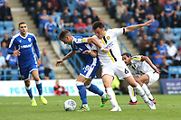 Mark Byrne of Gillingham and Burton Albion's Kieran Wallace challenge for the ball during Gillingham vs Burton Albion, Sky Bet EFL League 1 Football at The Medway Priestfield Stadium on 10th August 2019