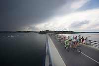 1st breakaway group over the bridge of the Lac de Pareloup with the threat of thunder behind them...<br /> <br /> stage 14: Rodez - Mende (178km)<br /> 2015 Tour de France