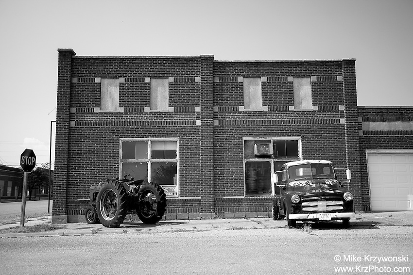 Historical Downtown Bldg. w/ Old Truck & Tractor in Coldwater, KS