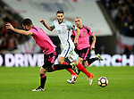 Adam Lallana of England passes the ball behind Grant Hanley of Scotland during the FIFA World Cup Qualifying Group F match at Wembley Stadium, London. Picture date: November 11th, 2016. Pic David Klein/Sportimage