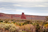 A rock formation showing the typical red soil in the Anelo district. Bodega Del Anelo Winery, also called Finca Roja, Anelo Region, Neuquen, Patagonia, Argentina, South America