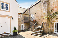 BNPS.co.uk (01202 558833)<br /> Pic: Symonds&Sampson/BNPS<br /> <br /> A charming home which features in a Thomas Hardy novel has emerged on the market for £500,000.<br /> <br /> Grade II listed Stinsford House, in the idyllic village of Stinsford, Dorset, is referenced in the writer's 1872 novel 'Under The Greenwood Tree'.<br /> <br /> It is believed that the tree in the courtyard is the one Hardy wrote about in the romantic tale.<br /> <br /> Hardy was very attached to the village which is on the outskirts of the market town of Dorchester. He was baptised at St Michael's Church in the village and his church group is thought to have performed at the 17th century property every Christmas Eve. Following his death in 1928, his second wife fulfilled Hardy's request for his heart to be buried at St Michael's Church, while his ashes were interred at 'Poets Corner' in Westminster Abbey.<br /> <br /> The property is being sold with estate agent Symonds & Sampson.