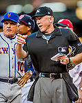 28 April 2017: MLB Umpire Lance Barksdale reviews the ground rules with New York Mets Manager Terry Collins prior to a game against the Washington Nationals at Nationals Park in Washington, DC. The Mets defeated the Nationals 7-5 to take the first game of their 3-game weekend series. Mandatory Credit: Ed Wolfstein Photo *** RAW (NEF) Image File Available ***