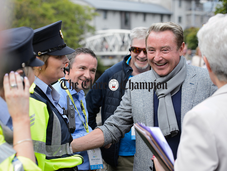 Michael Flatley has a laugh with Garda Sandra Heelan at the official opening of the All-Ireland Fleadh 2017 in Ennis. Photograph by John Kelly.