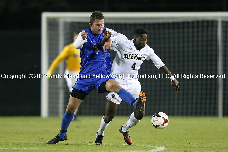 25 October 2013: Duke's Alex Sauciuc (left) and Wake Forest's Tolani Ibikunle (right). The Duke University Blue Devils hosted the Wake Forest University Demon Deacons at Koskinen Stadium in Durham, NC in a 2013 NCAA Division I Men's Soccer match. The game ended in a 2-2 tie after two overtimes.