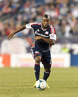 New England Revolution defender Andrew Farrell (2) brings the ball forward.  In a Major League Soccer (MLS) match, Montreal Impact (white/blue) defeated the New England Revolution (dark blue), 4-2, at Gillette Stadium on September 8, 2013.