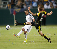 Galaxy defender Sean Franklin (28) gets the ball past Cres midfielder Eddie Gaven (12) during the second half of the game between LA Galaxy and the Columbus Crew at the Home Depot Center in Carson, CA, on September 11, 2010. LA Galaxy 3, Columbus Crew 1.
