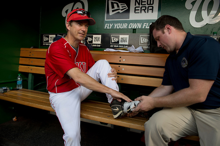UNITED STATES - JUNE 28:  Sen. Rand Paul, R-Ky., is taped up before the start of the 51st Annual CQ Roll Call Congressional Baseball Game held at Nationals Park.  The Democrats over the Republicans prevailed 18-5.  (Photo By Tom Williams/CQ Roll Call)
