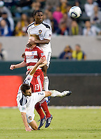 Edson Buddle forward of the LA Galaxy goes up high over FC Dallas midfielder Dax McCarty and teammate DemaKovalenko. The LA Galaxy defeated FC Dallas 2-1 at Home Depot Center stadium in Carson, California on Sunday October 24, 2010.
