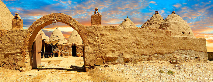 "Pictures of the beehive adobe buildings of Harran, south west Anatolia, Turkey.  Harran was a major ancient city in Upper Mesopotamia whose site is near the modern village of Altınbaşak, Turkey, 24 miles (44 kilometers) southeast of Şanlıurfa. The location is in a district of Şanlıurfa Province that is also named ""Harran"". Harran is famous for its traditional 'beehive' adobe houses, constructed entirely without wood. The design of these makes them cool inside. 40"
