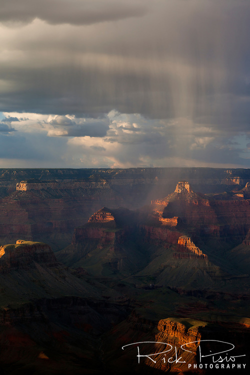 A summer squall passes over Grand Canyon National Park at sunset.