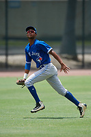 GCL Blue Jays left fielder Warnel Valdez (16) tracks a fly ball during a game against the GCL Phillies East on August 10, 2018 at Carpenter Complex in Clearwater, Florida.  GCL Blue Jays defeated GCL Phillies East 8-3.  (Mike Janes/Four Seam Images)