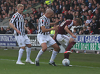 Jim Goodwin pressures Arvydas Novikovas as Gary Teale watches in the St Mirren v Heart of Midlothian Clydesdale Bank Scottish Premier League match played at St Mirren Park, Paisley on 15.9.12.