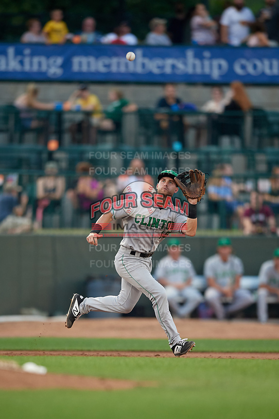 Clinton LumberKings third baseman Bubba Hollins (15) fields a batted ball during a Midwest League game against the Great Lakes Loons on July 19, 2019 at Dow Diamond in Midland, Michigan.  Clinton defeated Great Lakes 3-2.  (Mike Janes/Four Seam Images)