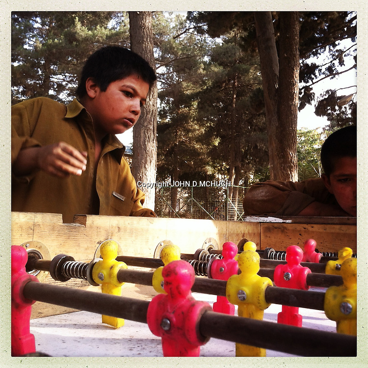 ** TO GO WITH AFGHANISTAN STORY FOR PETER MURTAGH - NO ARCHIVE, NO RESALE ** Young boys play table football in Shar-e-Now park in Kabul, 16 August 2012. (John D McHugh)