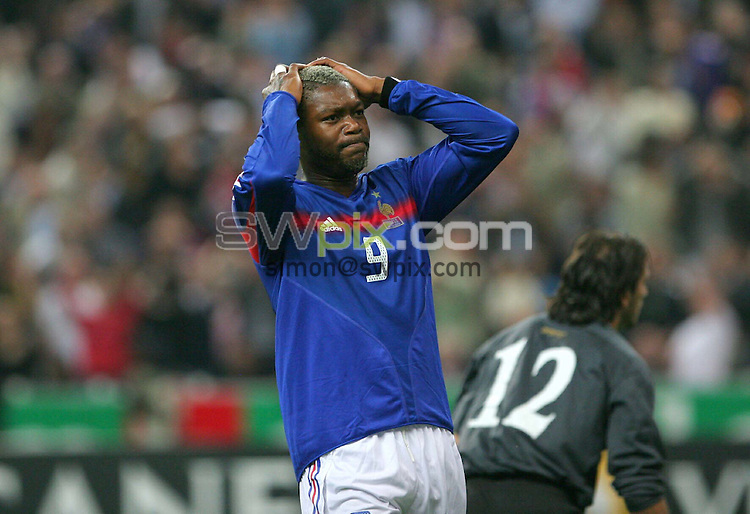 PIX: Football. World Cup 2006, European Qualifying Group 4. France-Cyprus, Stade de France, Paris-St. Denis, 12th October 2005...COPYRIGHT PICTURE>> SIMON WILKINSON>>0870 092 0092>>..France striker Djibril Cisse in dispair for his national team