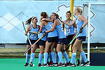 16 October 2015: North Carolina's Malin Evert (GER) (15) is mobbed by teammates after scoring the game's first goal. The University of North Carolina Tar Heels hosted the Duke University Blue Devils at Francis E. Henry Stadium in Chapel Hill, North Carolina in a 2015 NCAA Division I Field Hockey match. UNC won the game 2-1.