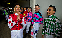 "LOUISVILLE, KY - MAY 04: Jockey Mike Smith says a prayer before joining other jockeys in honoring cancer survivors during the Survivor's Parade on Kentucky Oaks Day at Churchill Downs on May 4, 2018 in Louisville, Kentucky. Jockey's join as a show of support for Corey Lanerie's wife, Shantel. Several jockey's wore ""Fight with Shantel"" bands around their boots. (Photo by Scott Serio/Eclipse Sportswire/Getty Images)"