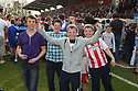 Jubilant Stevenage fans celebrate promotion after the Blue Square Premier match between Stevenage Borough and York City at the Lamex Stadium, Broadhall Way, Stevenage on Saturday 24th April, 2010..© Kevin Coleman 2010 ..
