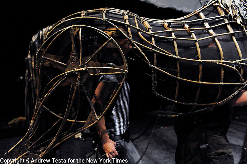 UK. London. 8th July 2009.Puppeteer Laura Cubitt controlling the hind of a horse  during a rehearsal of War Horse..©Andrew Testa for the New York Times
