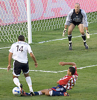 CD Chivas USA Def. Jason Hernandez slide tackles Houston Dynamo Fwd. Dwayne DeRosario while Chivas GK Preston Burpo looks on. Both teams played to a 1-1 draw during a MLS game at The Home Depot Center in Carson, California, Wednesday June 28, 2006.