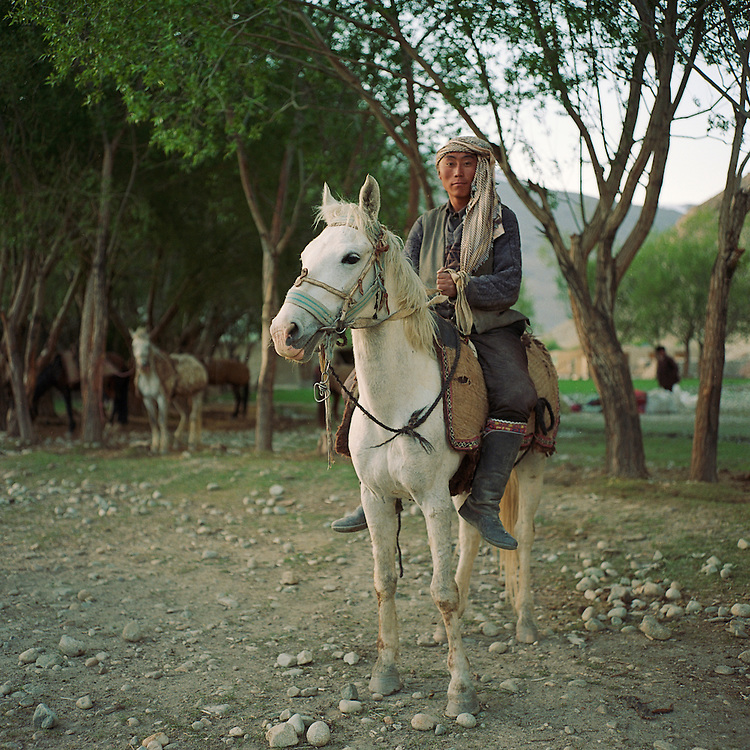 A Kyrgyz horseman prepares to go and check on his herd of sheep and goats outside of the village of Ghaz Khan.  The Pamir Kyrgyz live at high elevations on the Pamir Mountains and leave only during the spring and summer months.