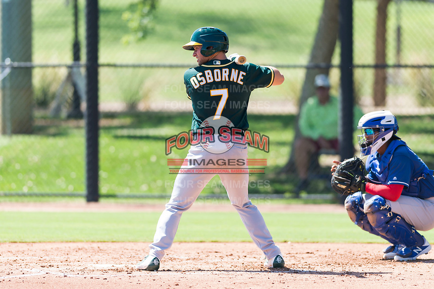 Oakland Athletics outfielder Nick Osborne (7) at bat in front of catcher Andres Noriega (83) during an Instructional League game against the Los Angeles Dodgers at Camelback Ranch on September 27, 2018 in Glendale, Arizona. (Zachary Lucy/Four Seam Images)