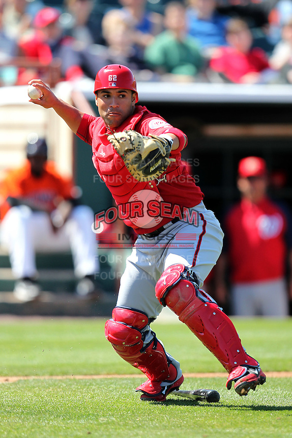 Harrisburg Senators catcher Sandy Leon #6 throws to first during a game against the Bowie BaySox at Prince George's Stadium on April 8, 2012 in Bowie, Maryland.  Harrisburg defeated Bowie 5-2.  (Mike Janes/Four Seam Images)