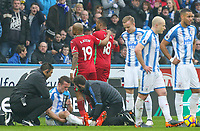 Swansea City's Jordan Ayew is lead off the field by Andre Ayew after being shown a straight red card <br /> <br /> Photographer Alex Dodd/CameraSport<br /> <br /> The Premier League - Huddersfield Town v Swansea City - Saturday 10th March 2018 - John Smith's Stadium - Huddersfield<br /> <br /> World Copyright &copy; 2018 CameraSport. All rights reserved. 43 Linden Ave. Countesthorpe. Leicester. England. LE8 5PG - Tel: +44 (0) 116 277 4147 - admin@camerasport.com - www.camerasport.com