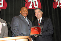 14 January 2007: Bob Bowlsby presents an award to Ekom Udofia at the annual football banquet at McCaw Hall in Stanford, CA.