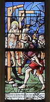 Saints Crispin and Crispinian, patron saints of cobblers, at Soissons, hanging by their armpits at the gallows while soldiers cut them with knives and the governor Rictus Varus looks on, from the Scenes of the Life and Martyrdom of Saints Crispin and Crispinian stained glass window, attributed to Nicolas le Prince, donated in 1530 by the cobblers guild in Gisors, in the Collegiate Church of Saint-Gervais-Saint-Protais, built 12th to 16th centuries in Gothic and Renaissance styles, in Gisors, Eure, Haute-Normandie, France. The church was consecrated in 1119 by Calixtus II but the nave was rebuilt from 1160 after a fire. The church was listed as a historic monument in 1840. Picture by Manuel Cohen