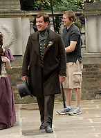 "MATTHEW MacFADYEN as an elderly man mistakenly wanders into the scene.On the set of Charles Dickins serial novel, period drama ""Little Dorrit"" filming near St. John's Church in Hampstead, London, England, Bank Holiday Monday, August 25th 2008..filmset film set Full length costume Victorian funny hat brown coat sound man smiling .CAP/IA.©Ian Allis/Capital Pictures"