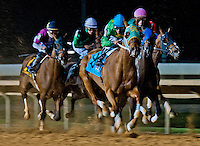 The field passes the stands for the first time in the Sugar Maple Stakes on Charles Town Classic Night at Charles Town Races & Slots in Ranson, West Virginia on April 14, 2012.