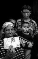Montenegro  Novembre 2000.Campo profughi di Konik 1.Tataria, etnia rom,mostra il documento del marito morto  in Kosovo durante la guerra rimasta sola con 5 figli.