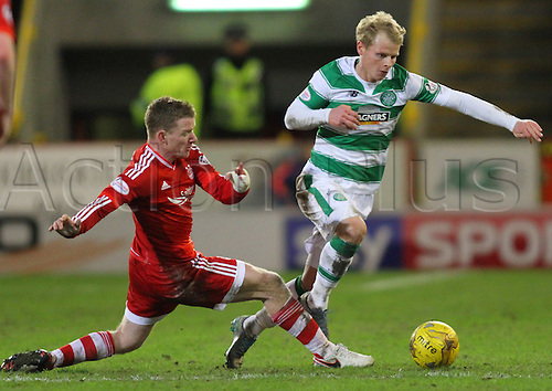 03.02.2016. Pittodrie, Aberdeen, Scotland. Scottish Premier League. Aberdeen versus Celtic. Gary Mackay-Steven is tackled by Jonny Hayes