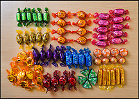 BNPS.co.uk (01202 558833)<br /> Pic: TomWren/BNPS<br /> <br /> The contents of a tub of Quality Streets today.<br /> <br /> An original member of the Quality Street lineup has made way for a new chocolate after 80 years. <br /> <br /> The Toffee Deluxe was created in 1919 as a sweet in its own right and was included in the first ever box of Quality Street when it was invented in 1936.<br /> <br /> The stalwart, that has a brown wrapper, has now bitten the dust and has been ditched in favour of the new 'Honeycomb Crunch' sweet.