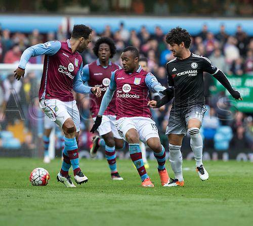 02.04.2016. Villa Park, Birmingham, England. Barclays Premier League. Aston Villa versus Chelsea.  Aston Villa striker Jordan Ayew protects the ball from Chelsea striker Alexandre Pato.